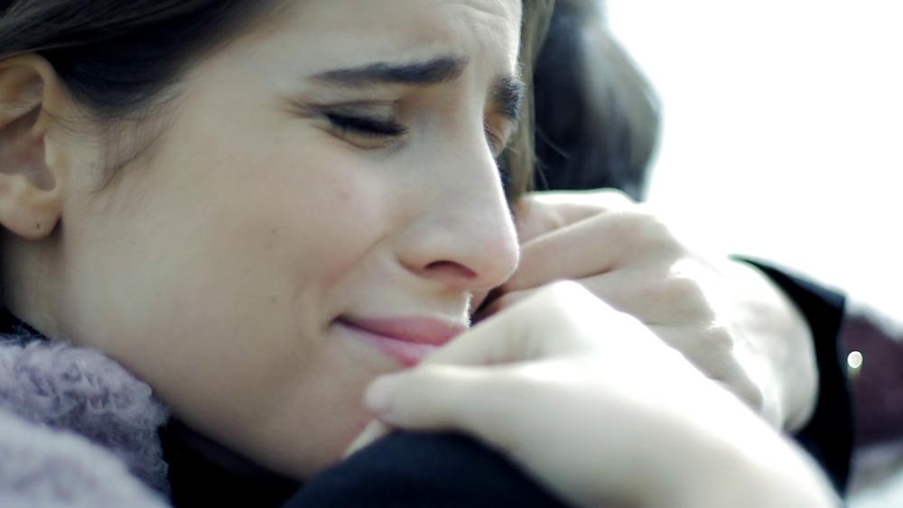 videoblocks-sad-woman-in-love-hugging-boyfriend-crying-slow-motion-closeup_sghyqabtx_thumbnail-full06.png