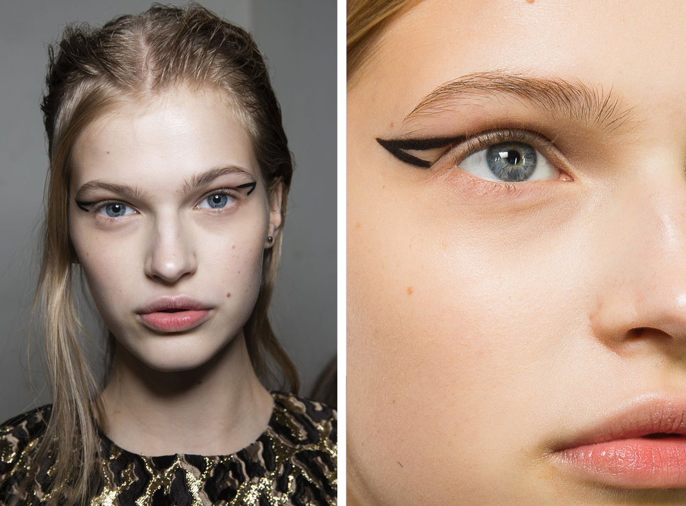 "The vibe:  Edgy   Get the look:  Models wore a fresh take on winged liner, with the ""wings"" made of floating open triangles at the outer corners."
