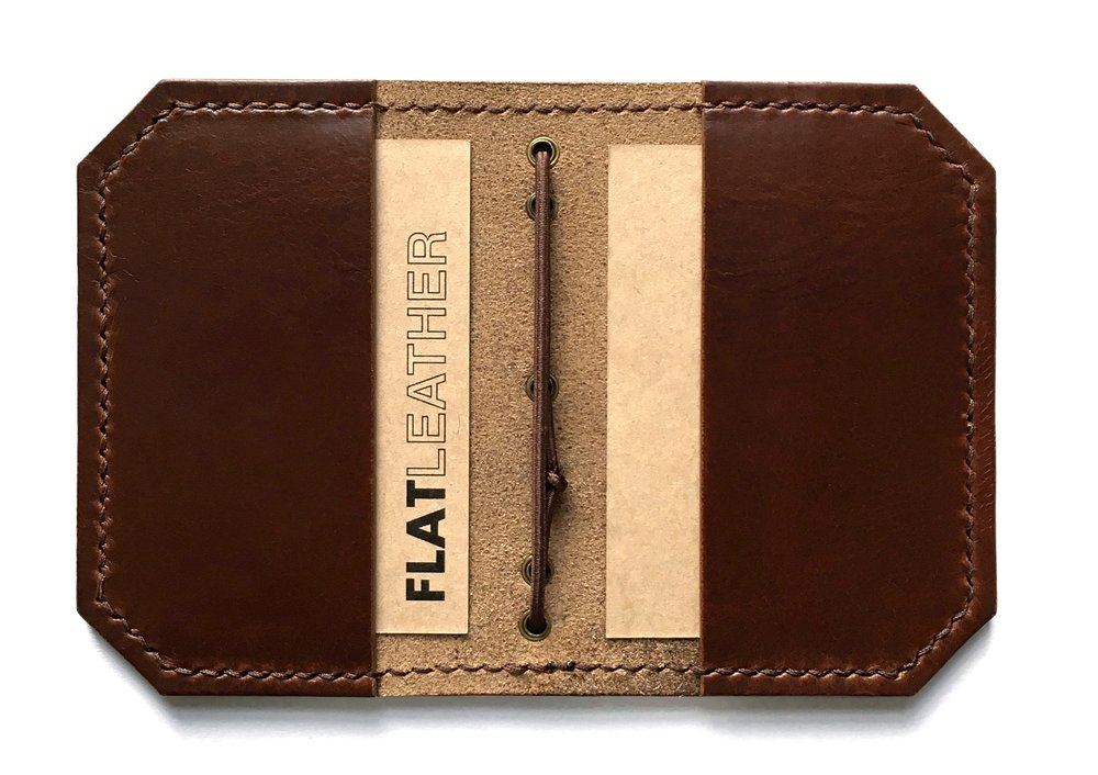 Flat Wallet - The original Flat Wallet. Inspired by the Traveler's Notebook, the Flat Wallet is a two pocket wallet with a loop of elastic that both stores your bank notes securely and keeps your wallet shut. Handmade using Horween full grain leather, the Flat Wallet is an essential everyday carry. Available in Chocolate, Black and English Tan.