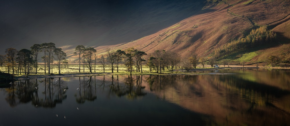 The iconic Buttermere Sentinels catching the first light. On a calm day they look incredible, and the flock of birds add a little extra dimension to the scene.