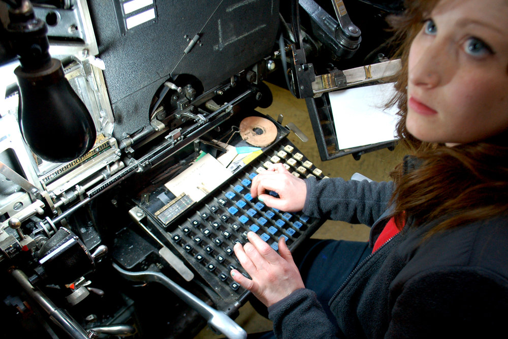 "In this meander book workshop, a typography student tries her typing skills on the Intertype's ""non-qwerty"" keyboard before casting her name in hot metal."