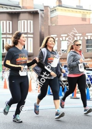 My mother (center)  bribing my sister & I to run 😂  we picked up the pace when we saw the cameras!