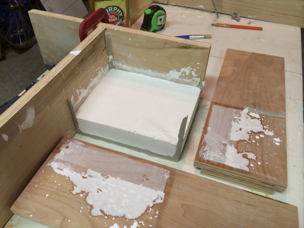 Removing the cottle boards after the plaster cured.
