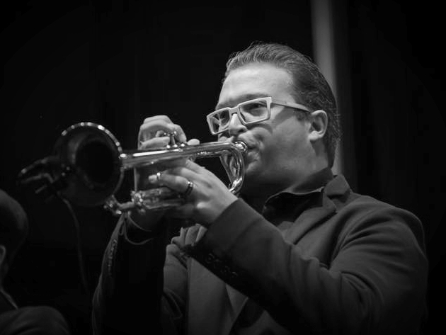 - Mitchell Cooper, trumpet, is the newest member of the Big Bad Voodoo Daddy horn section.