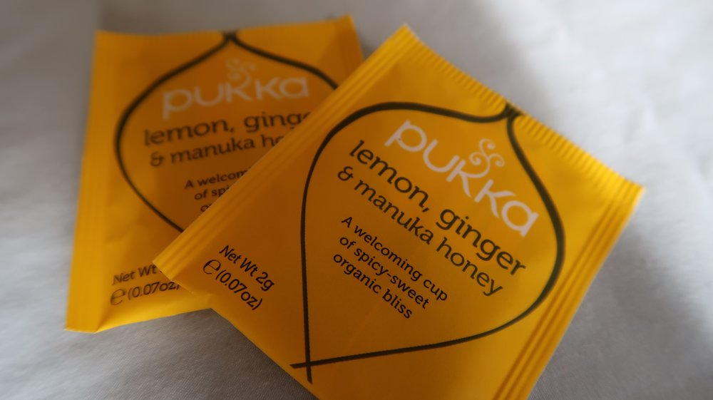 There are lots of herbal teas which contain ginger, alternatively you could just add ginger root to hot water.