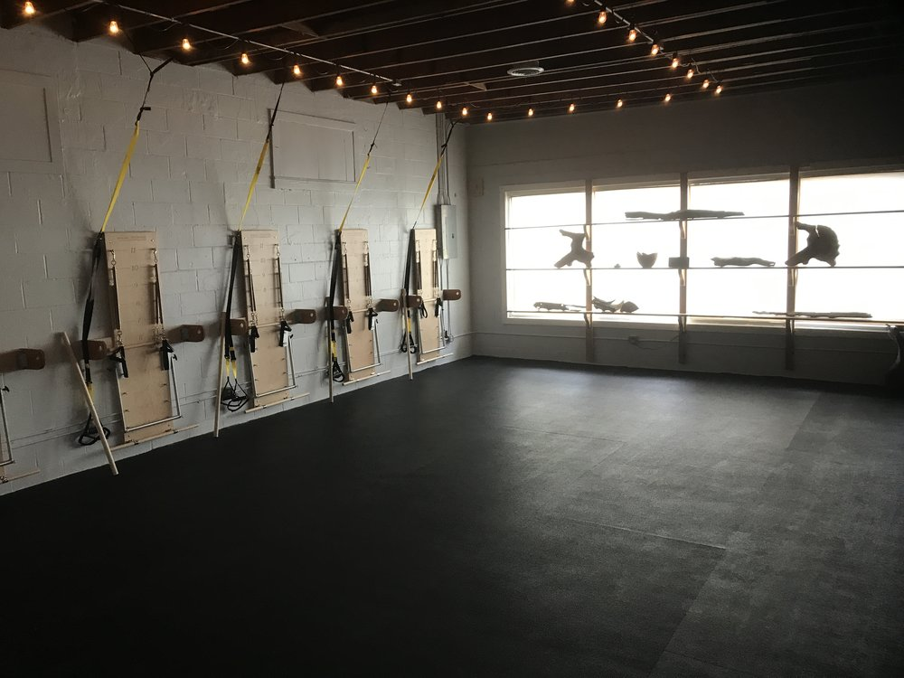 We have 10 stations for our equipment classes, each with a Balanced Body Springboard, a ballet barre, and a TRX trainer at each.