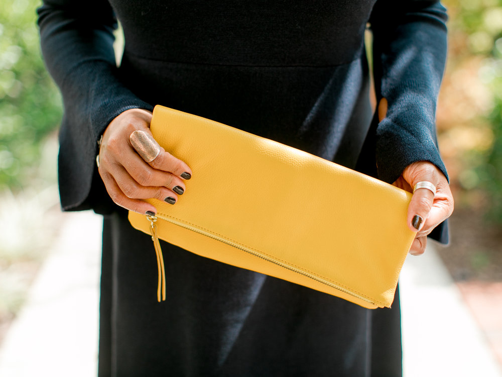 Style Tip! - When wearing a neutral color...black or navy...a  pop of color in the accessory is sometimes a must have.  I added the yellow clutch bag with the neutral shoe and minimize the jewelry.