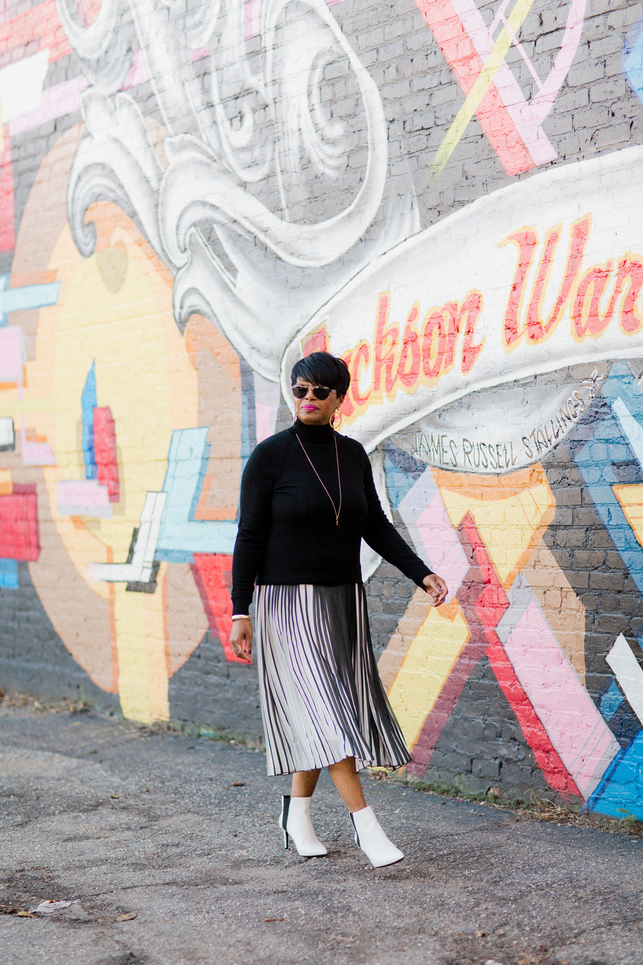 black and white stripe skirt black turtleneck.jpg
