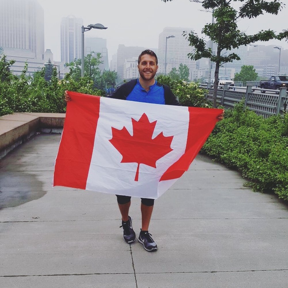 Me holding a Canadian flag in Ottawa on Canada Day