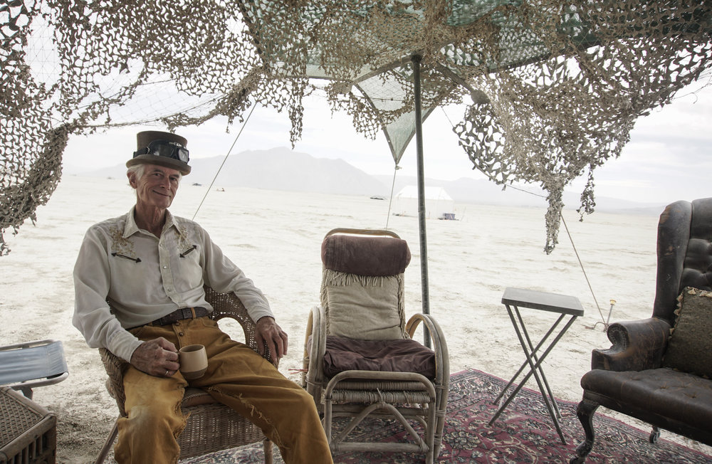 Burning Man co-founder Michael Mikel, known as Danger Ranger to festival goers, sits at his camp in the Black Rock Desert during  Burning Man 2017 .