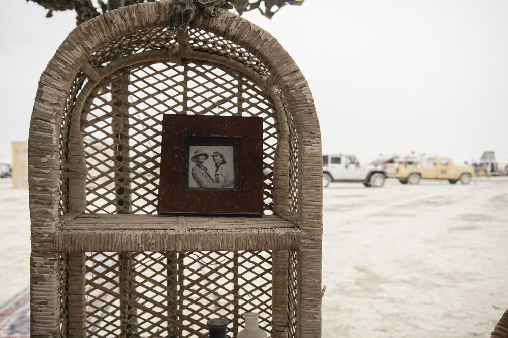 A photo of Burning Man co-founder Michael Mikel and his wife Dusty is displayed at Mikel's camp in the Black Rock Desert during  Burning Man 2017 .