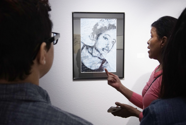 "Artist Lolita Develay explains the thought process behind her work at an opening reception for "" A Room of One's Own""  at Left of Center Gallery in Las Vegas in March 2017."