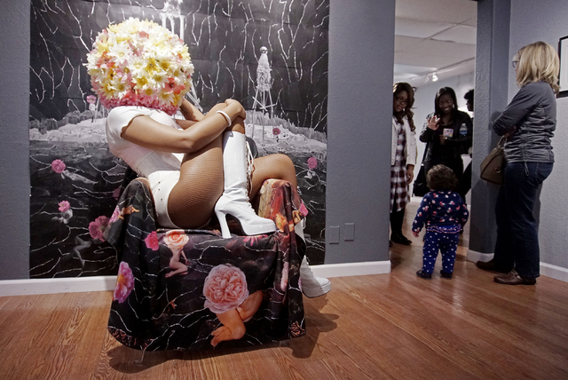 "A performer poses as part of artist JK Russ's performance art piece during an opening reception for "" A Room of One's Own "" at Left of Center Gallery in Las Vegas in March 2017."
