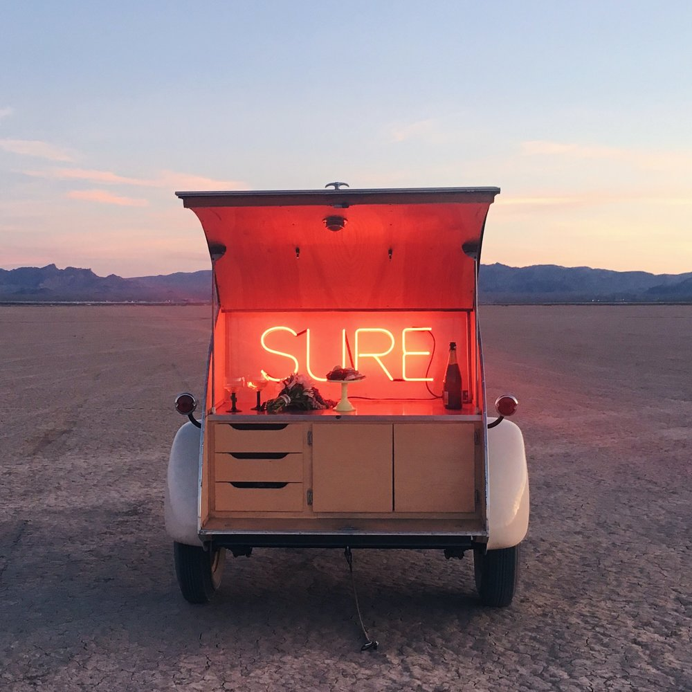 Flora Pop uses a tiny teardrop-shaped trailer to host pop-up weddings in the Nevada desert.