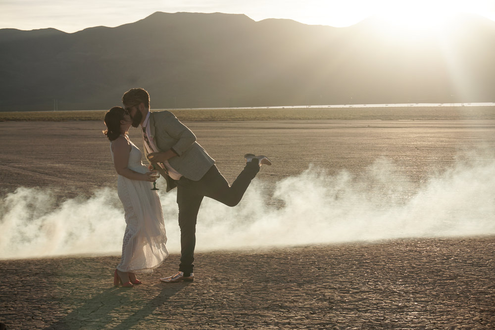 Newly weds Shannon Bray, left, and Joe Brown celebrate after getting married at the Eldorado Dry Lake Bed outside Las Vegas with  Flora Pop.