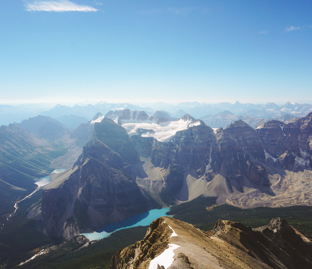 The view of Moraine Lake (R) from over 11,000ft at the summit of Mount Temple.