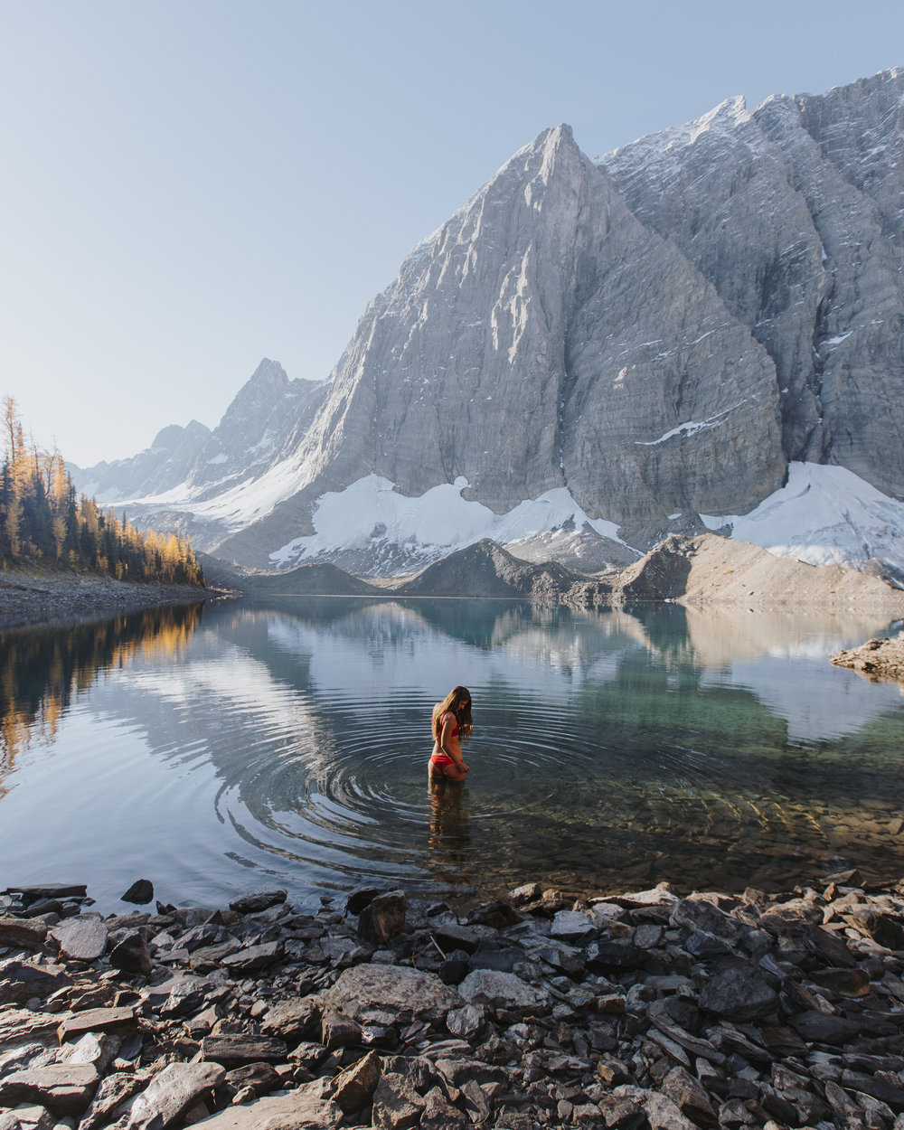 First light on the rockwall face and a morning swim in Floe Lake, photo / Bruin Alexander