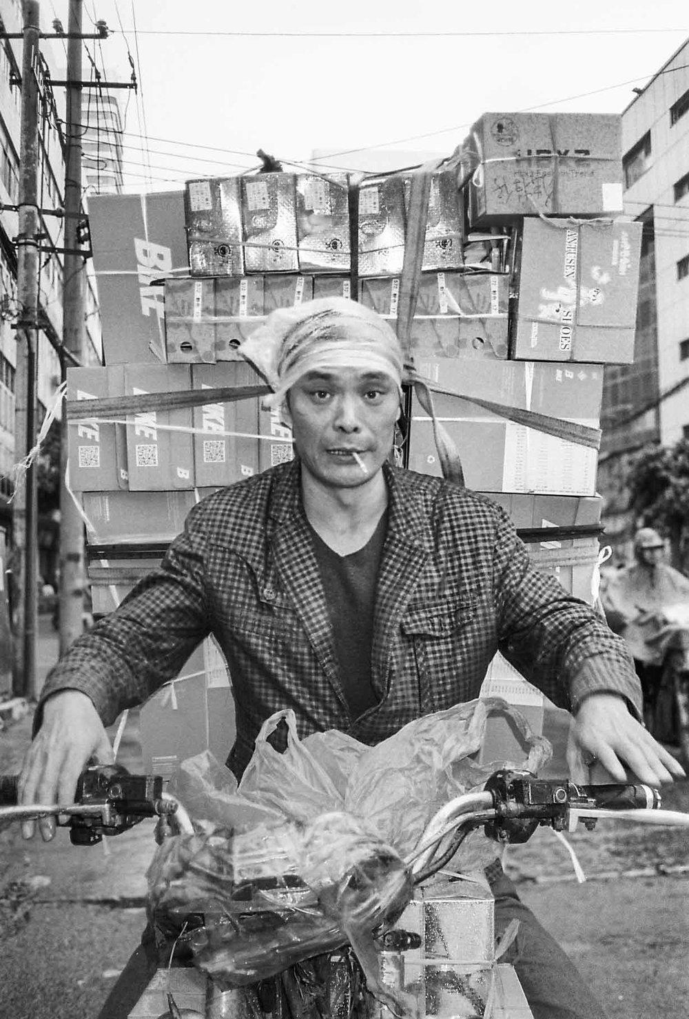 Porter. Lotus Market, Chengdu, May 2018.