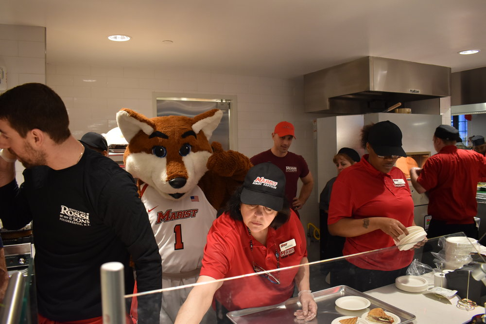 Frankie the Fox helping Rossi's and Sodexo staff prepare food samples.