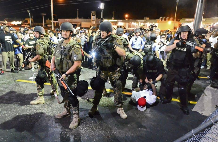 Police during Black Lives Matter riot in Ferguson, Missouri, armed with tear gas, rifles, and grenade launchers. Photo Source: http://theconversation.com