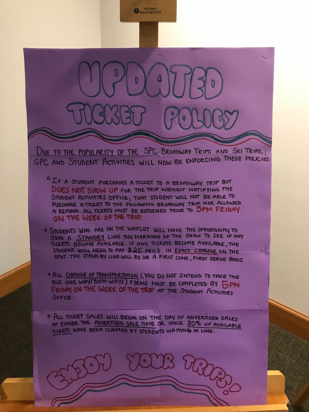 A poster with the updated ticket policy hangs in the Student Center. Photo by Amanda Guy.