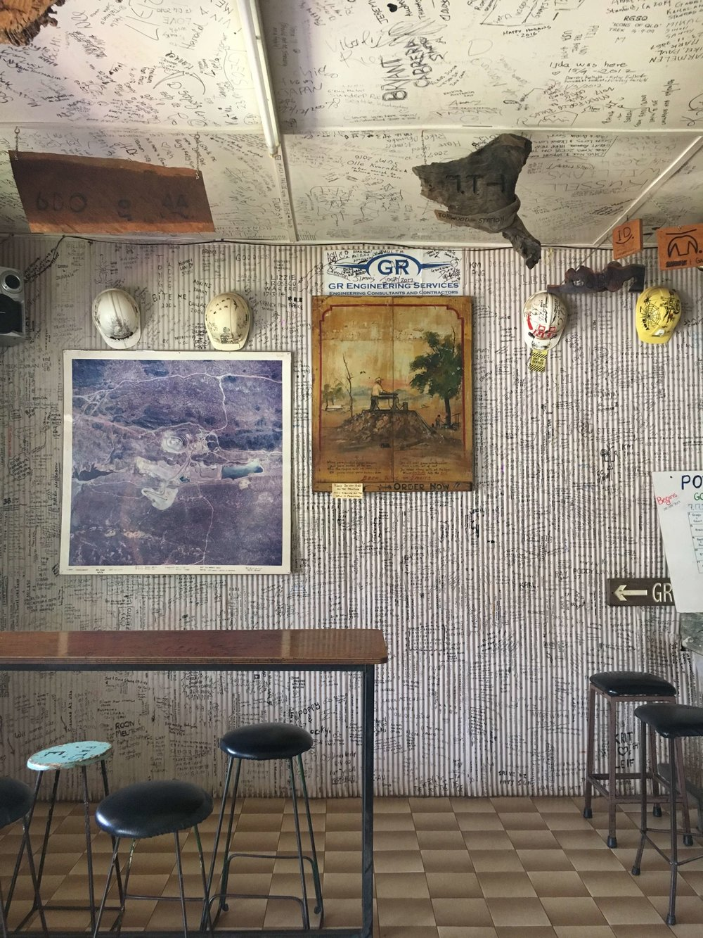 The Post Office Hotel at Chillagoe, where visitors leave their mark. Can you spot a glimpse of the bar counter? It's made of local marble from nearby quarries.