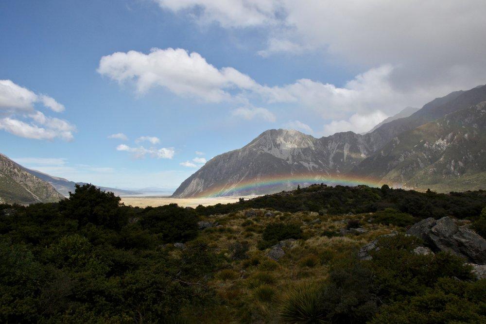 A blue sky and rainbow in Aoraki Mount Cook National Park.