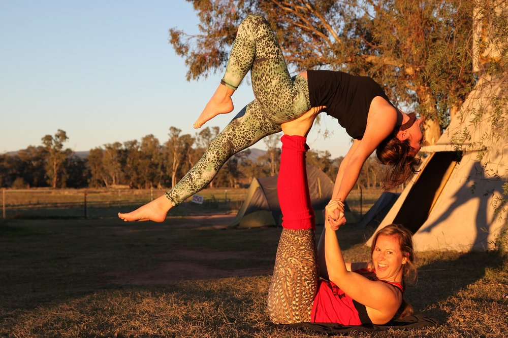 It wasn't all protests, here Emma and Jules practice acroyoga at Camp Wando in Maules Creek.
