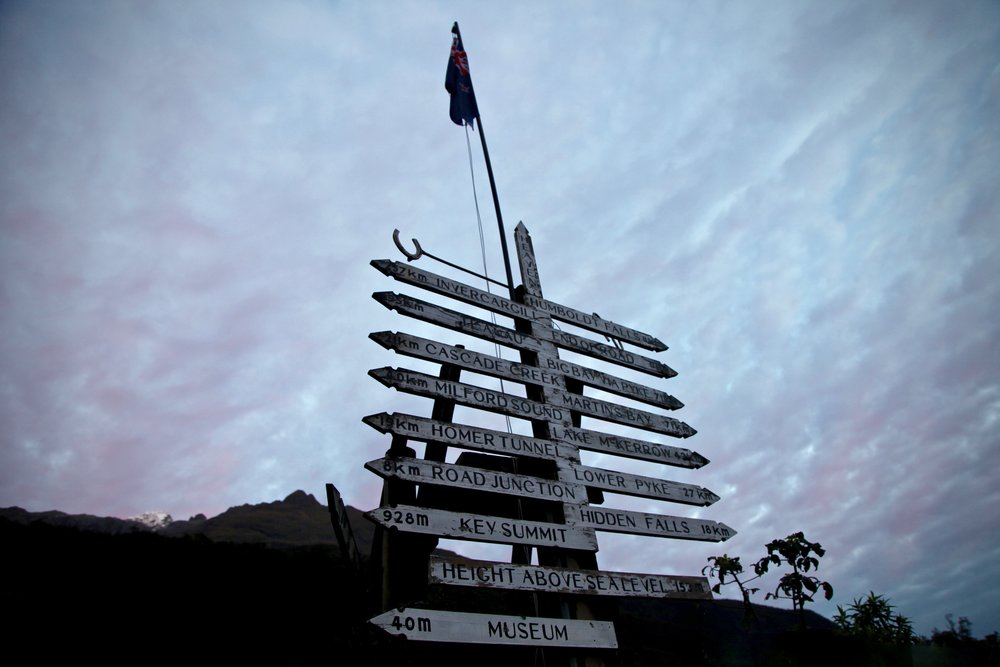 The signpost at Gunn's Camp in the Hollyford Valley on New Zealand South Island.