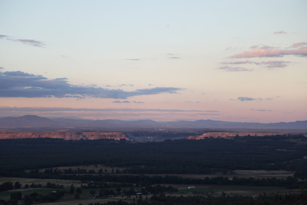 A sunset view over Bulga and the Mount Thorley Warkworth open-cut coal mines. April 2015.