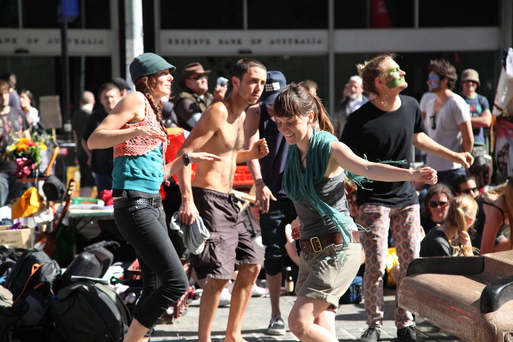 Dancing outside of the Reserve Bank of Australia in Martin Place during Occupy Sydney in October 2011. Occupy Sydney was part of the global 'Occupy' movement that saw people take to the streets and occupy spaces (like Martin Place) to share ideas and take action for issues of social and economic justice.