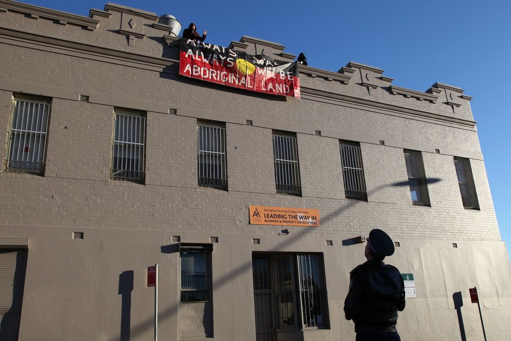 Locals and their supporters gather to protest commercial redevelopment of The Block in Redfern, July 2014.