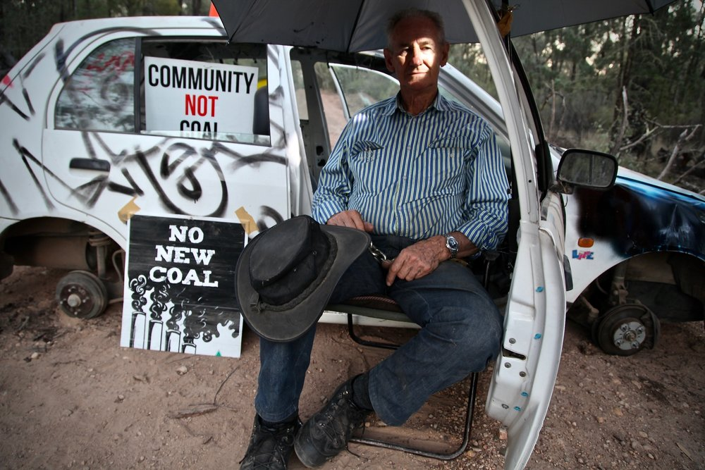 """Hundreds of people risked arrest to protest the destruction of Leard State Forest to make way for open-cut coal mining. On of those people is, 75-year-old Raymond McLaren (pictured), from Tamworth, who has never taken part in this kind of activity before. Mr McLaren said, """"This protest is a remarkable convergence of people with a common interest in protecting a unique forest. I am here to defend the forest."""""""