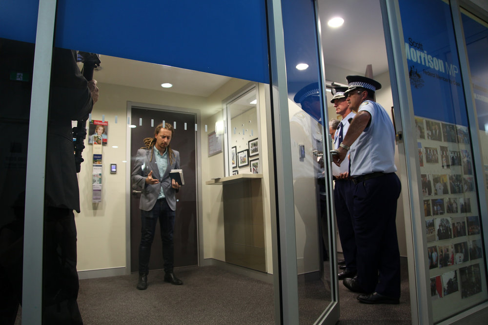 Police watch during the first Love Makes A Way action in Scott Morrison's Sydney office.