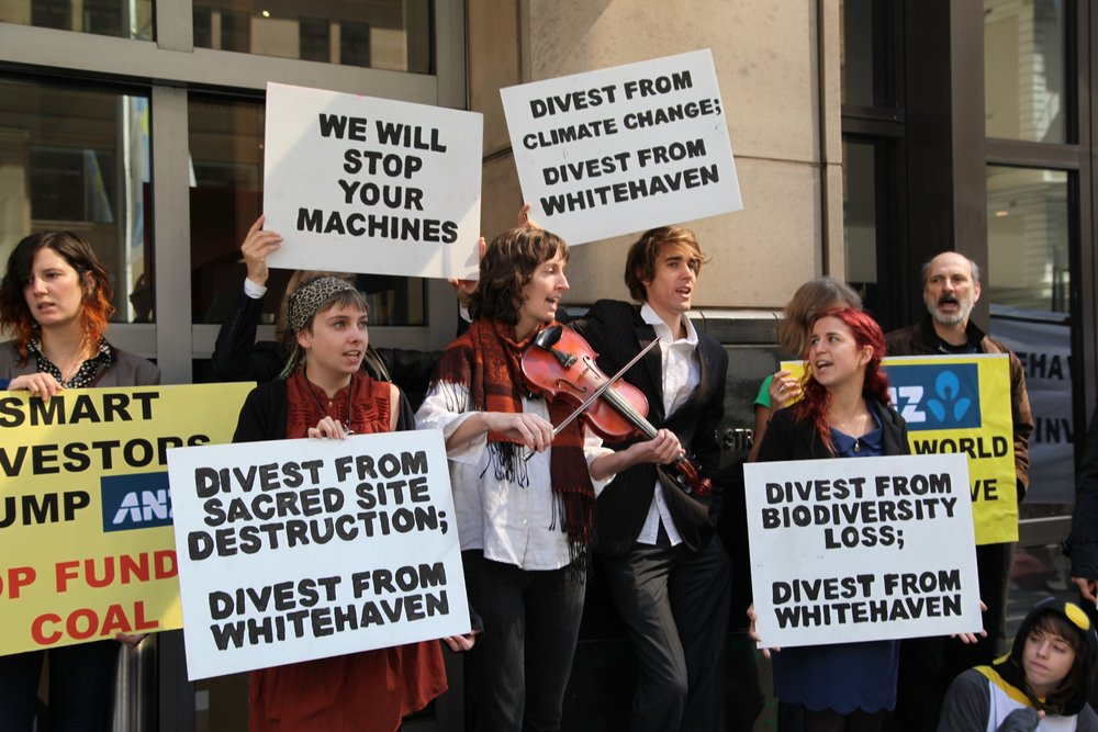 Whitehaven Coal operate the coal mine in Leard Forest, near Maules Creek. Protesters pictured here gather to protest in Sydney CBD outside of the company's annual general meeting where it reports back to shareholders about the money it has made from ventures like the Maules Creek coal mine. November 2013.