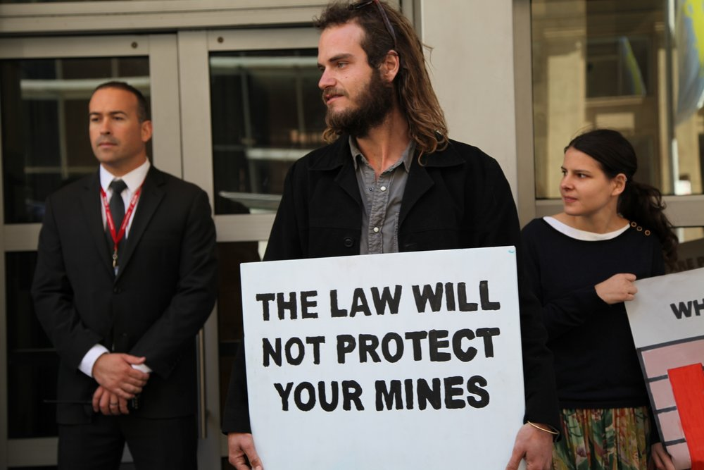 Protesting Whitehaven Coal's Maules Creek Coal Project at the company AGM in Sydney CBD.