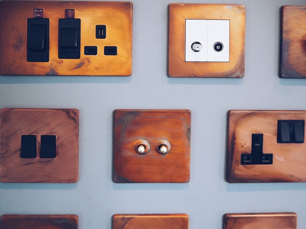 Dowsing & Reynolds copper plug sockets and light switches.