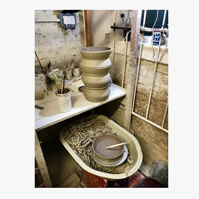Turning time. #annabelsmayfair duck salad #bowls are now leather hard and ready to turn; this is when I trim the excess clay and carve a footring. Turning take a lot of time, more than throwing, so I get everything ready and stack my pieces to save as much time as possible  #productionpottery #ceramics #pottery #handmade #craft #thrownonthewheel #maker #britishmade #restaurant #design #northstreetpotters #adriangonzalezpottery #stoneware #madeinlondon #ballclay #tableware #sets #highfired