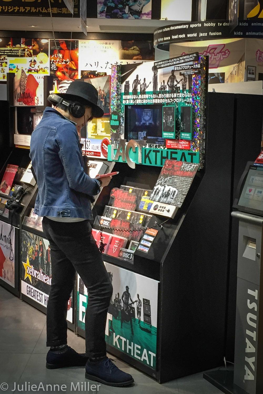 japanese guy listening to tunes.jpg