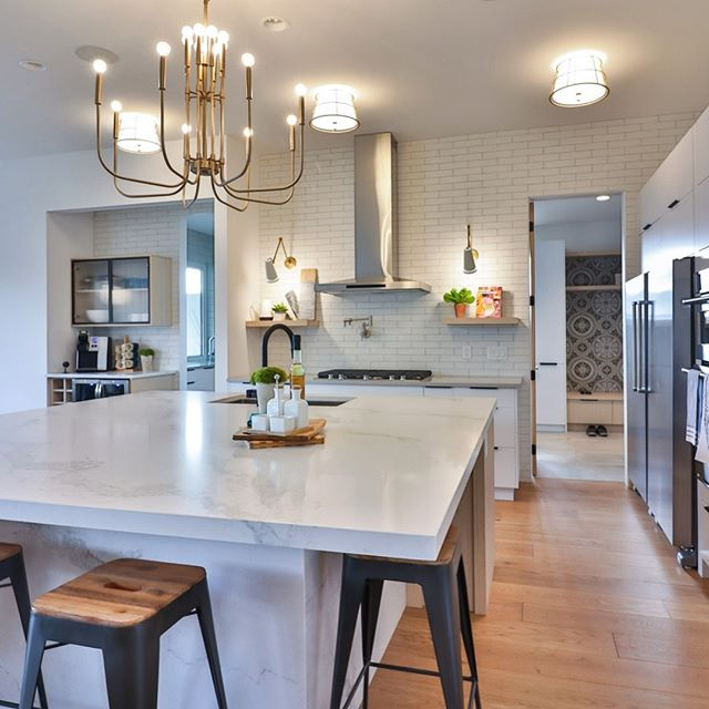 "My kitchen installer calls this client's island ""the continent"" because it is so oversized. #lindatrenholmdesign #kitchendesign #kitchenisland #showhome"