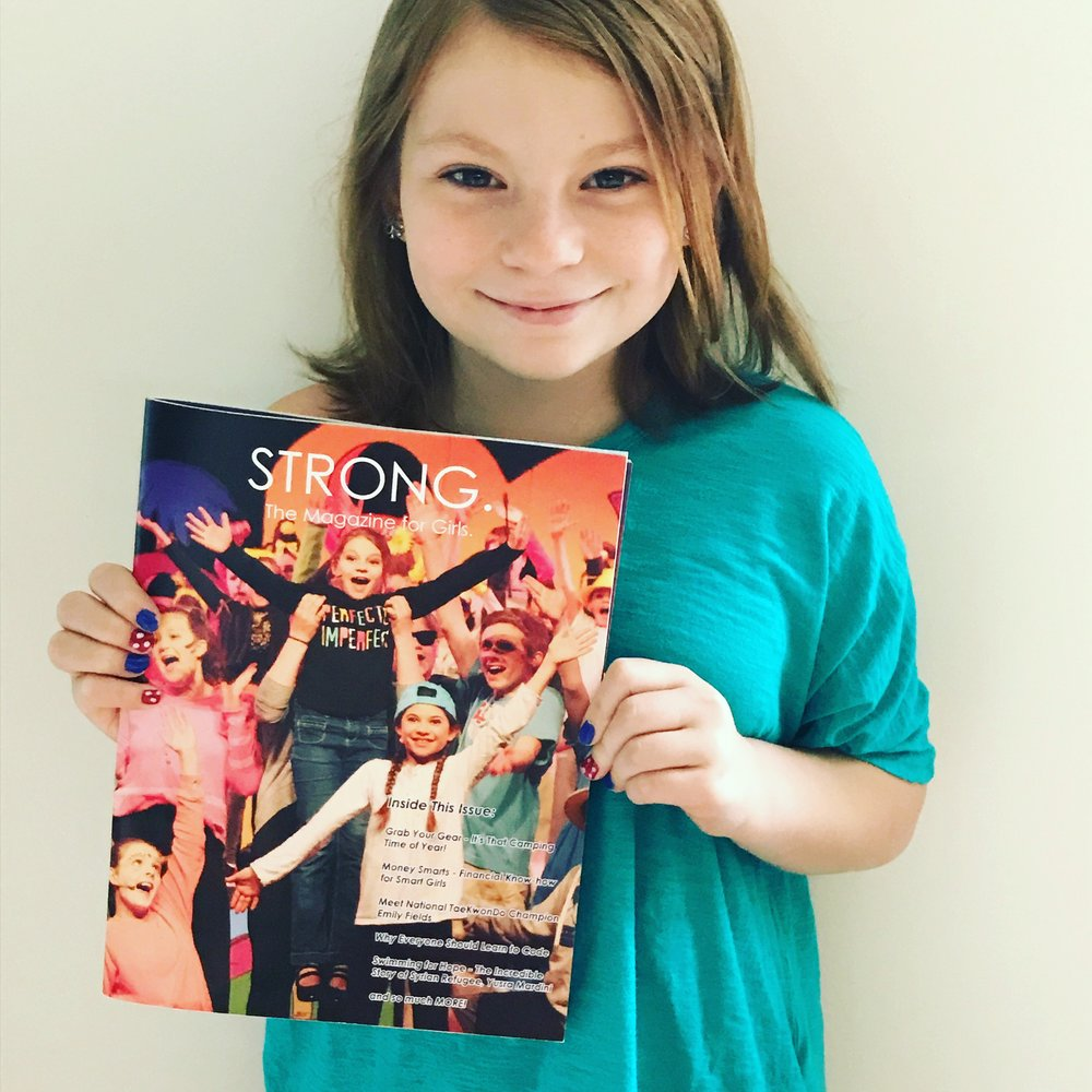 The cover girl holding up the first (sample) print copy of STRONG!