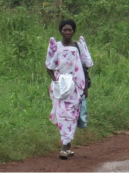 A woman wearing a gomesi