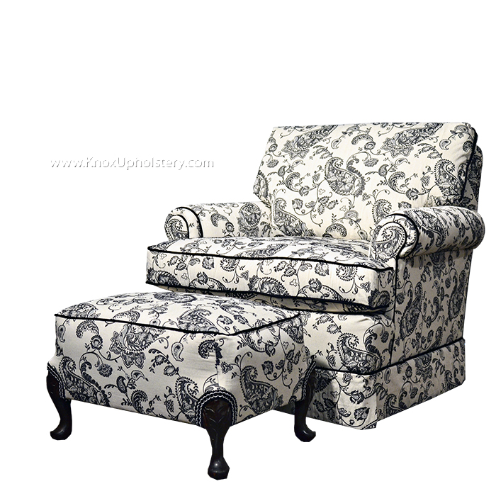 Black and white floral arm chair and matching ottoman