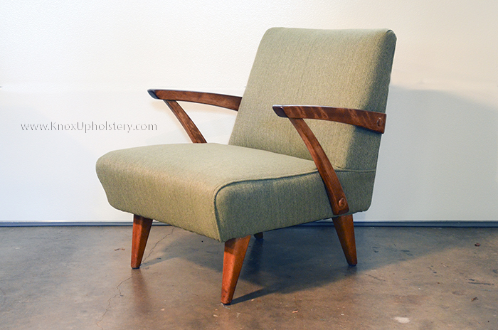 Mid-century-modern arm chair with show wood