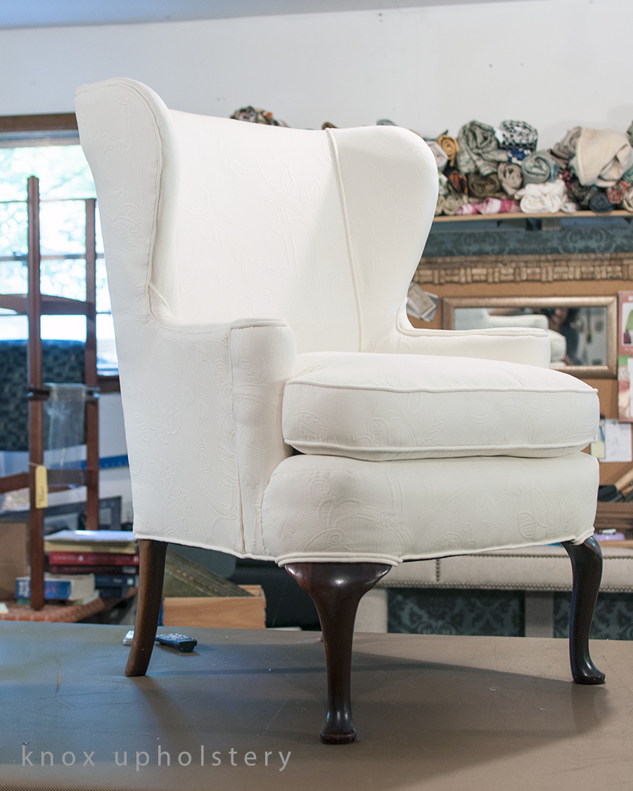 White upholstered wingback chair