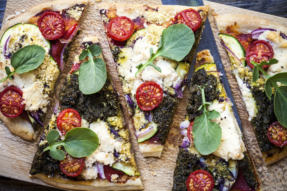 Pesto pizza with spicy cress goes oh so well with almond ricotta.