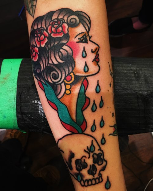 Traditional crying woman tattoo by German
