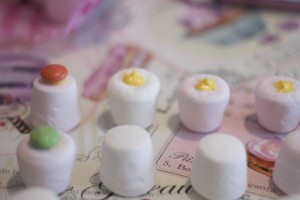 Marshmallows with yellow candy melt chocolate and Smarties
