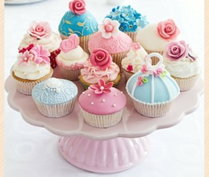 plate of cupcakes with different types of icing