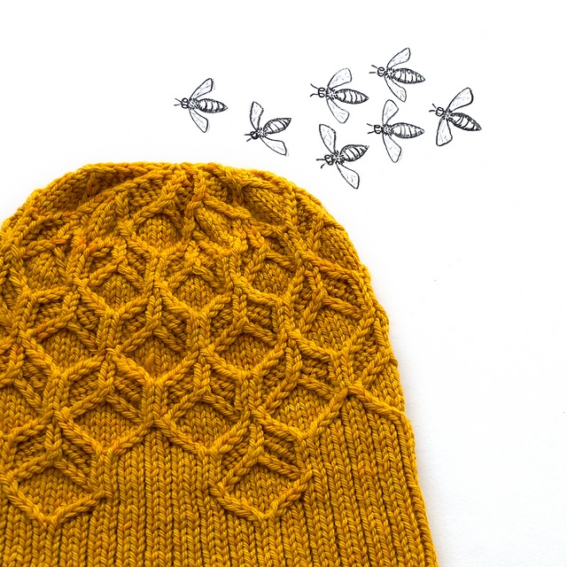 Another design with great texture is Amy van de Laar's Beeswax Hat. I love everything about this close-fitting toque, from the color to the clever mini cables. Another plus — the pattern gives instructions for working them without a cable needle. If you like the hat, you might fall equally hard for the matching cowl, mitts, and scarf.